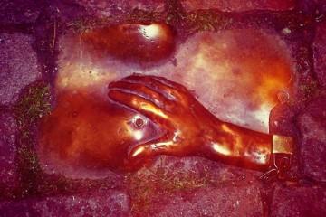 Amsterdam-tit-grabbing-cobblestone-sculpture