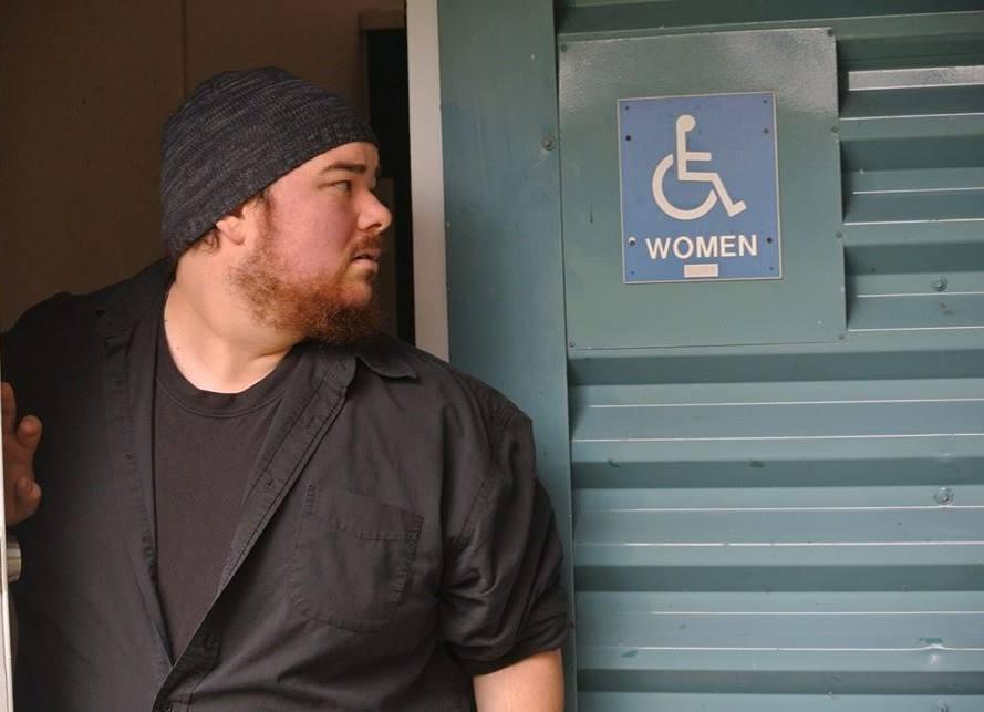 Jonas looking at bathroom sign