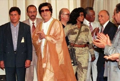 Gaddafi in the 1980's wearing something inspried by Prince - Via Flickr
