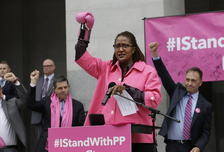 Sen. Holly Mitchell rallies for Planned Parenthood while wearing a pink boxing glove Via - http://depauliaonline.com