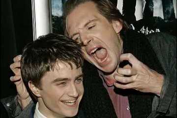 Ralph Fiennes hamming it up with Radcliff