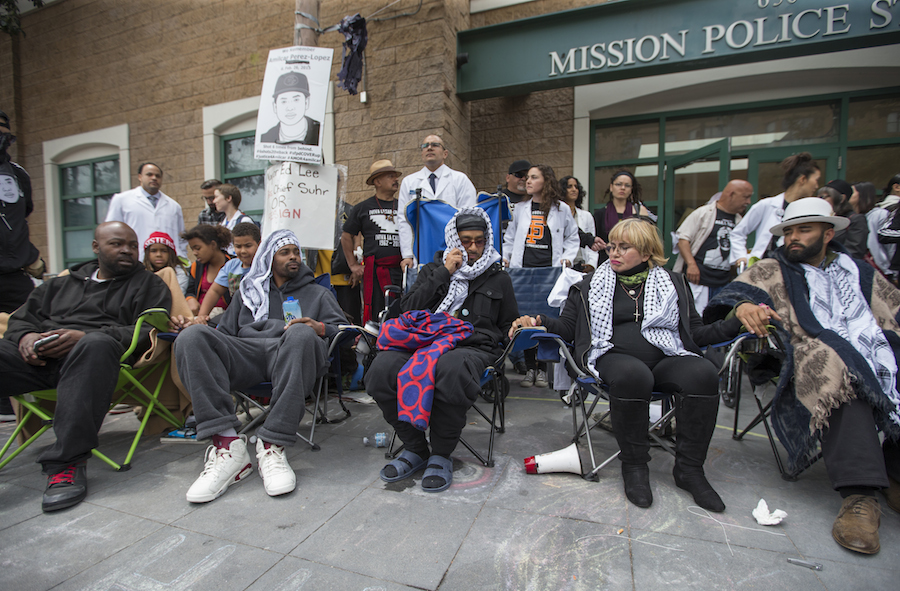 Five hunger strikers (from left) Ike Pinkston, Sellassie Blackwell, Ilyich Sato, Maria Cristina Gutierrez and Edwin Lindo sit together before a march to City Hall from the Mission Police Station at 17th and Valencia Streets in San Francisco, Calif. Tuesday, May 3, 2016. Five San Francisco residents have been on a hunger strike for thirteen days calling for the resignation of SFPD Chief Greg Suhr following recent police violence. (Jessica Christian/S.F. Examiner)