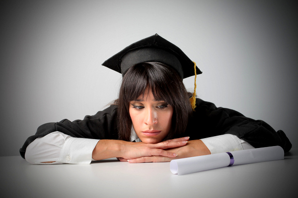 girl college graduate looking at useless degree