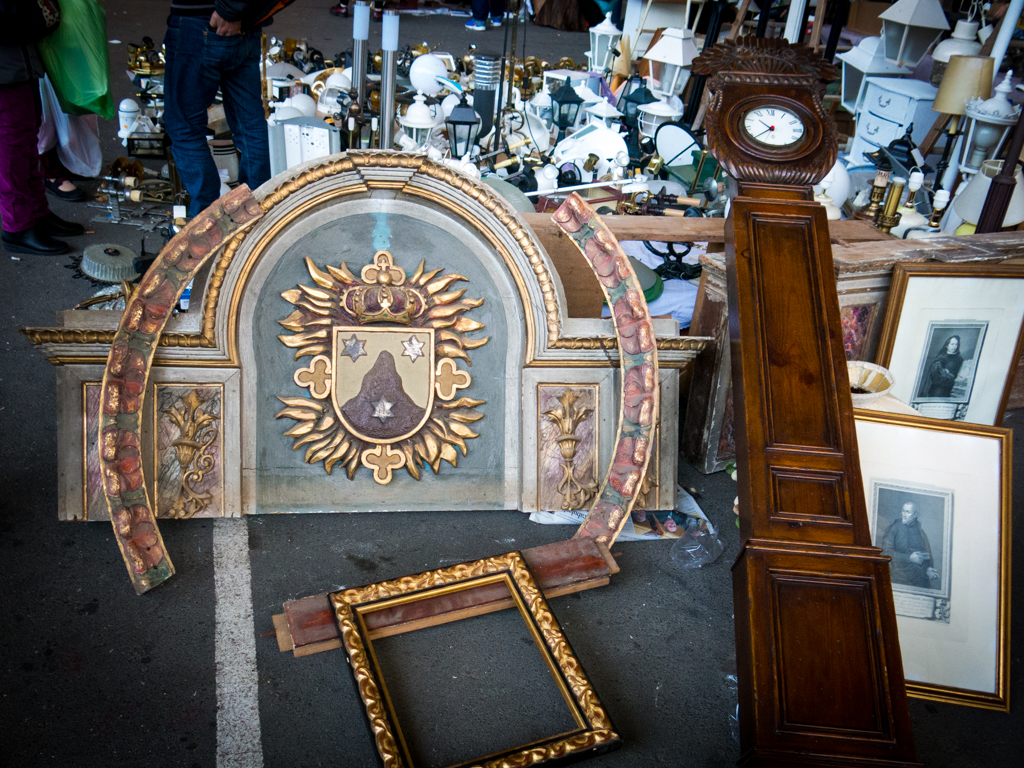 This grandfather clock and a very regal headboard, perhaps the remnants of the Czar's bedroom, which can now be yours for mere pennies.