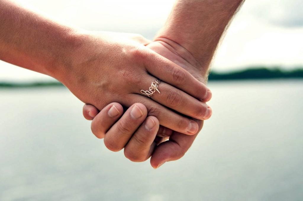 hope hand holding