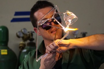 Gremlin constructs a kinetic glass sculpture.