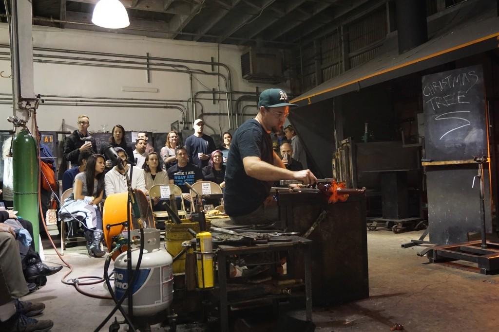 Lance Fraser manipulates molten glass.