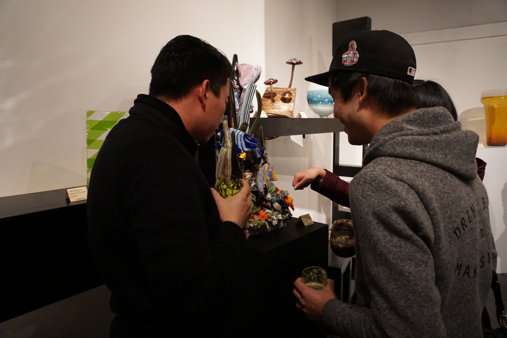 Eric Yue (left) and Jason Kwan examine a glass scupture.