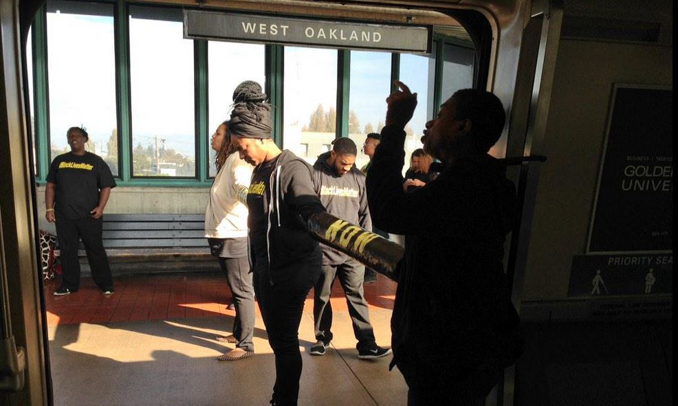 Black Lives Matter activists demonstrate at an Oakland BART station