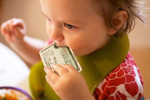 little-girl-baby-eating-credit-card
