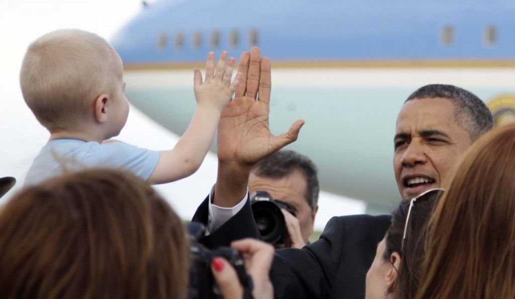 President Barack Obama greets people on the tarmac as he steps off of Air Force One as he arrives at at Buckley Air Force Base, Tuesday, April 24, 2012, in Aurora, Colo. (AP Photo/Carolyn Kaster)
