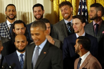 Jun 4, 2015; Washington, DC, USA; San Francisco Giants right fielder Hunter Pence (back row, second from right) gestures as President Barack Obama (front) speaks during a ceremony honoring the World Series champion San Francisco Giants in the East Room at the White House. Mandatory Credit: Geoff Burke-USA TODAY Sports