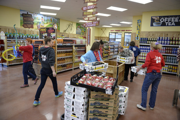 DENVER, CO - FEBRUARY 14: Employees at the new Trader Joe's, located on Colorado Blvd. and East 8th Avenue in Denver, get ready for the grand opening of specialty grocer, February, 14 2014. Two other Trader Joe's locations in Colorado will also open today. (Photo by RJ Sangosti/The Denver Post via Getty Images)