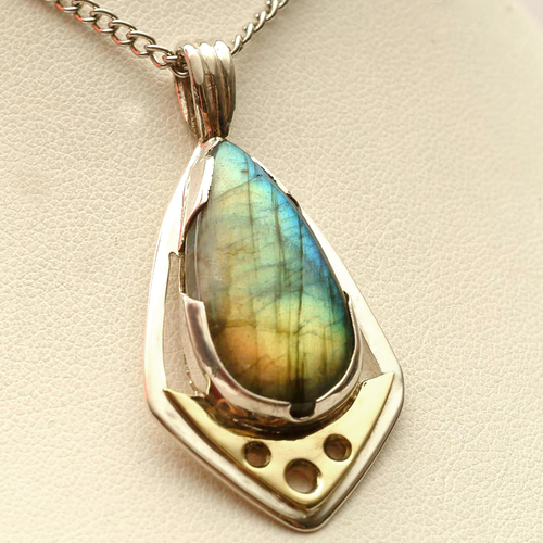 An example of one of Josh's earlier pendants made with labradorite.
