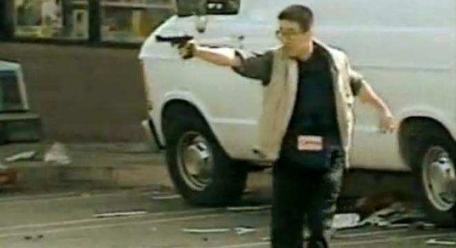 Joo firing rounds at armed assailants.