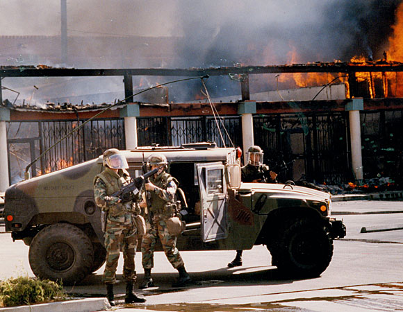 National Guard troops at Martin Luther King Boulevard and Vermont Avenue. (April 30, 1992) (J. Albert Diaz / Los Angeles Times)
