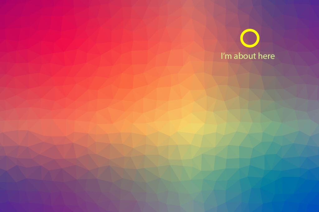 Photo of a color gradient showing all the colors merging together with a circle on a magenta like color with the text I am here